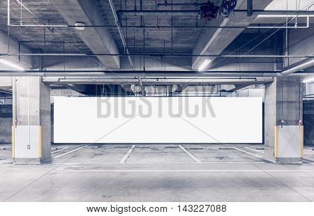 Parking garage underground interior with blank billboard Empty billboard Blank big billboard