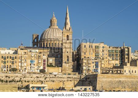 Valletta, Malta.  View of Basilica of Our Lady of Mount Carmel.  One of three cathedrals of the Anglican Diocese of Gibraltar in Europe St Paul's Pro-Cathedral tower is also visible.