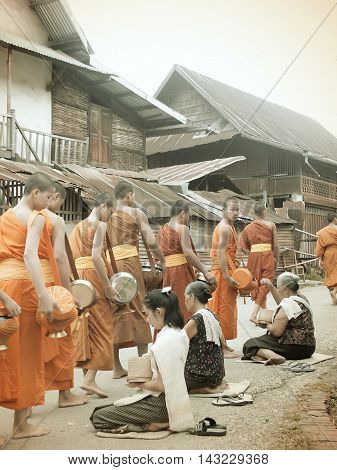 The Old Days Of Alms Giving To The Monks In Luang Prabang, Lao Pdr