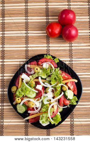 Top View On A Fresh Vegetable Salad With Natural Ingredients