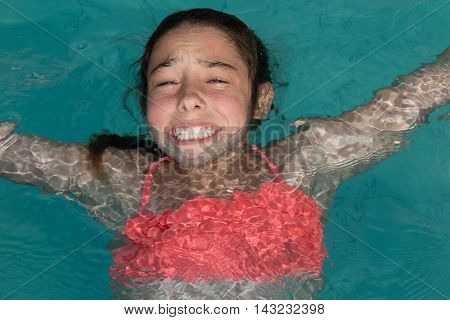 Young Girl Learning To Swim Is Afraid Of Water And Have Allergy On Chlorine Disinfection In Water