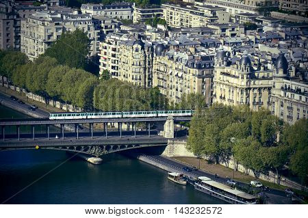 Metro Train Crossing Passy Bridge Over The Seine River In Paris, France