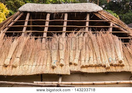 Roof grass thatching construction on frame building structure