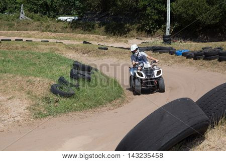 Young man driving quad bike enjoying the ride