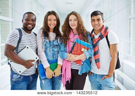 Portrait of classmates standing at university