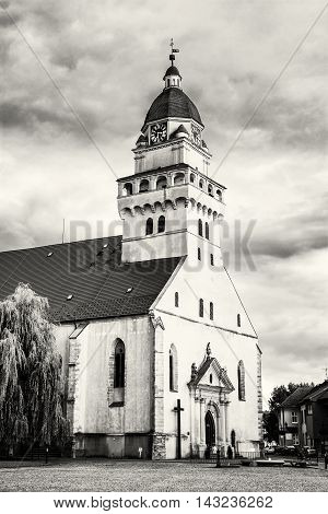 Parish church of saint archangel Michael Skalica Slovak republic. Religious architecture. Black and white photo. Travel destination. Cultural heritage. Beautiful place. Vertical composition.