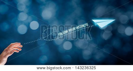 Follow your business instincts concept. Businessman throw a paper plane and text follow your instincts.