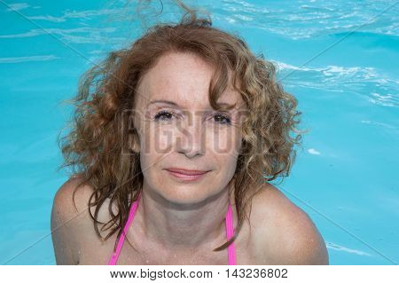 Cute Girl Is Relaxing At A Swimming Pool In Summer