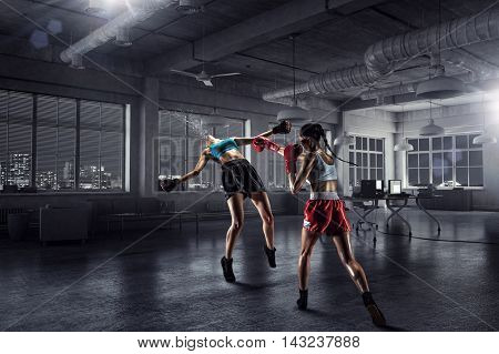 Girls boxing in office . Mixed media