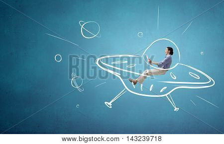 Girl flying in spaceship . Mixed media