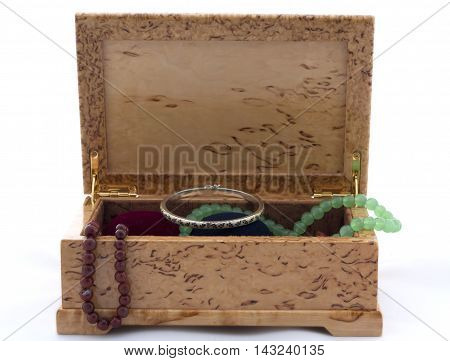 Box Of Karelian Birch With Jewels On White Background