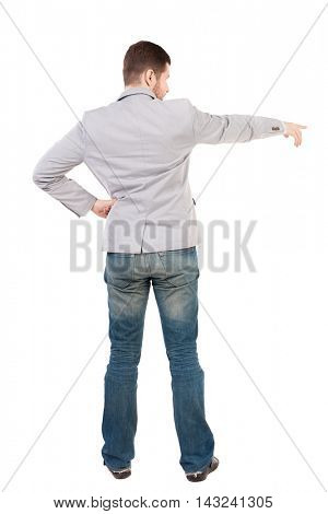 Back view of pointing business man.  Rear view people collection.  backside view of person.  Isolated over white background. A guy in a gray jacket instructs.