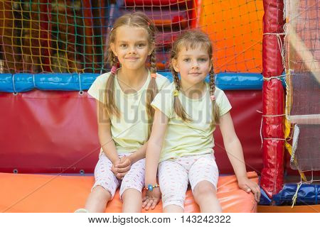 Two Girls Sit On A Soft Exit From The Game Room