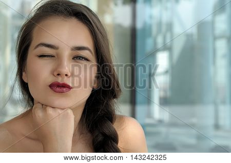 Girl With Pigtail Laid Her Chin On Her Fist.
