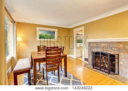 Cozy Dining Area With Wooden Table Set And Fireplace