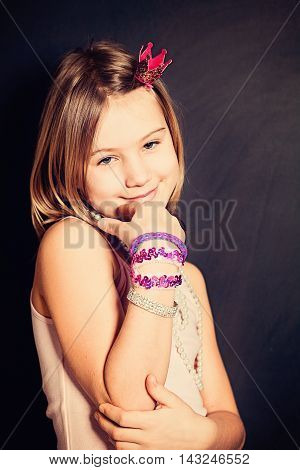 Cute Smiling Little Girl with Children's Jewelry or Bijouterie