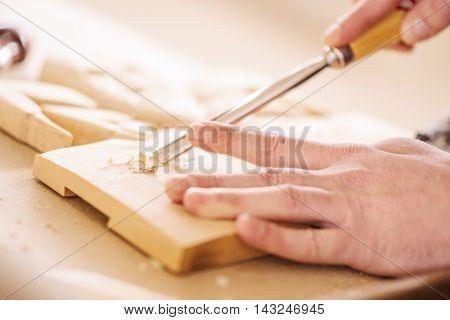 Carpenter at work. Wood engraving, close up.