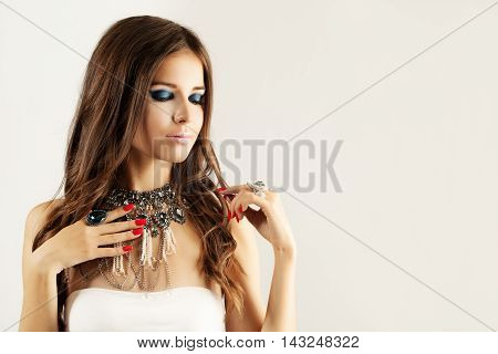 Pretty Girl Fashion Model. Jewelry Diamond Rings and Necklace. Smokey Eyes Makeup