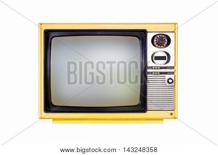 Old yellow television isolated on white background