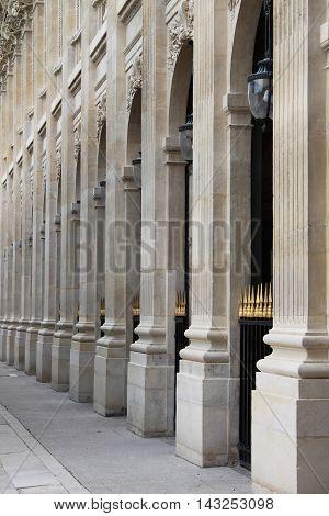 Perspective view of a renaissance colonnade in Paris, France