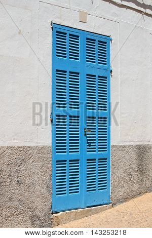 An italian style house entrance with shutters
