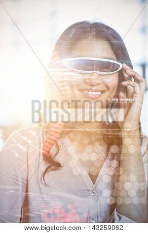 Composite image of face against businesswoman using virtual 3d glasses