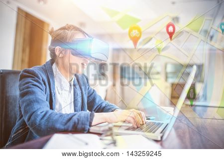 Map app against young woman in virtual reality glasses using laptop