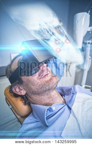 Close up of a x-ray of a human skull against smiling man using virtual reality