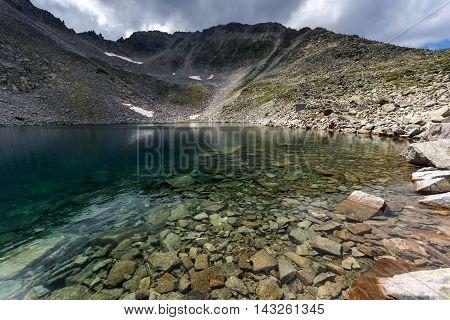 Amazing view of Ledenoto (Ice) Lake, Musala Peak and Trionite, Rila mountain, Bulgaria