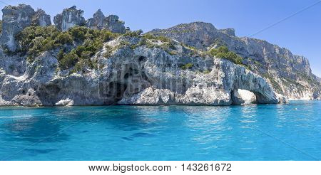 Panorama Of Blue Sea And The Rocky Coast In The Gulf Of Orosei Sardinia Italy