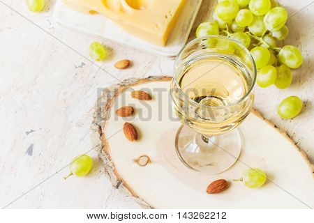 Glass of white wine and grapes copy space.
