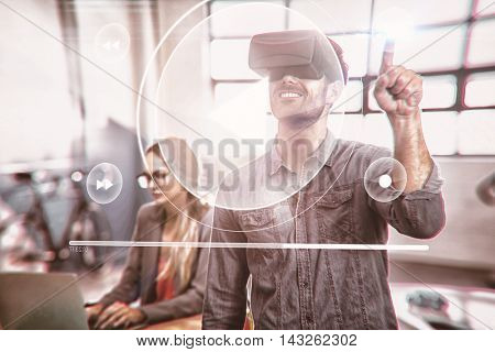 Music player interface against male graphic designer using the virtual reality headset