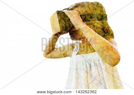 Girl wearing virtual reality simulator against branches and leaves