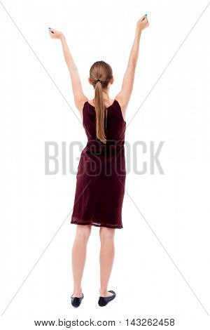 Back view of  woman.  Raised his fist up in victory sign.    Raised his fist up in victory sign.  Rear view people collection.  backside view of person.  Isolated over white background. A girl in a