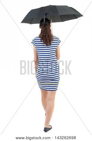 young woman in dress walking under an umbrella. Rear view people collection.  backside view of person.  Isolated over white background. Swarthy girl in a checkered dress goes under the umbrella