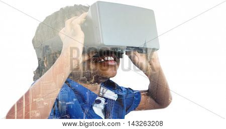 Boy wearing virtual reality simulator against image of a city landscape on a sunny day