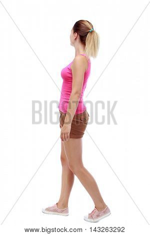 back view of walking  woman. beautiful blonde girl in motion.  backside view of person.  Rear view people collection. Isolated over white background. Sport blond in brown shorts thoughtfully looks