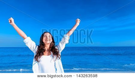 Happy woman smiling at the beach on a sunny day