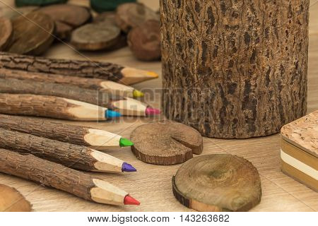 wood colored natural pencils and various wooden decorations