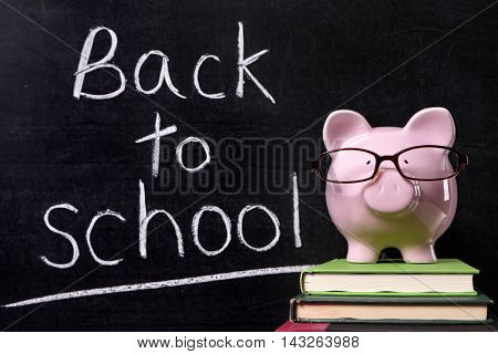 Back to school message reminder, classroom blackboard, piggy bank