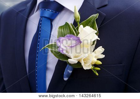beautiful groom's boutonniere of lilies and roses