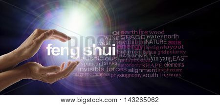 Shedding light on Feng Shui - Female hands cupped around the words FENG SHUI surrounded by a relevant word cloud with a spiraling bright light vortex behind