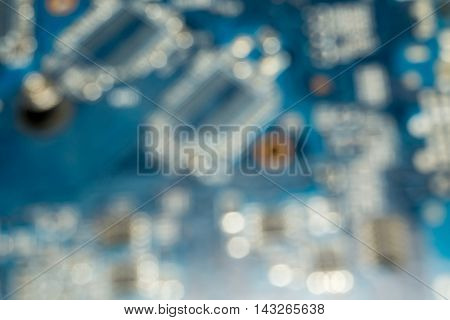 Blue electric circuit board close up background.
