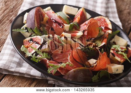 Salad With Figs And Parma Ham Dressed With Balsamic Sauce. Horizontal