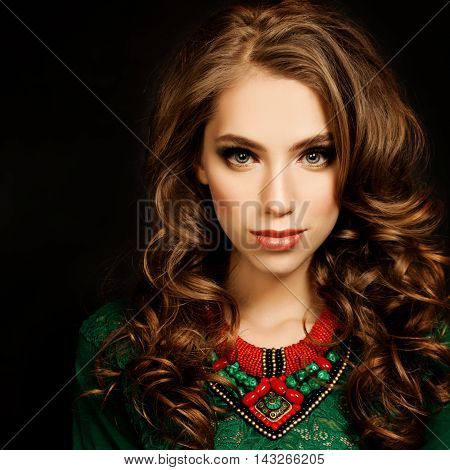 Curly Hair Girl. Beautiful Fashion Model Woman. Curly Colouring Hairstyle and Makeup