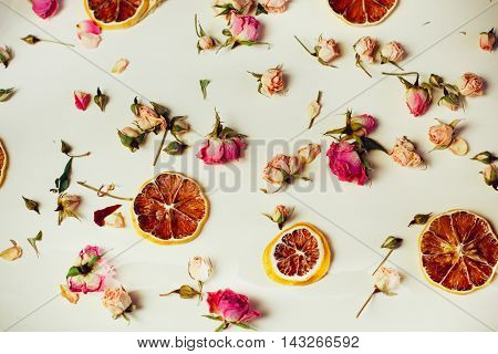 Beautiful Background With Roses And Dried Flowers Dried Round Slices Of Lemon Laid On A White Backgr