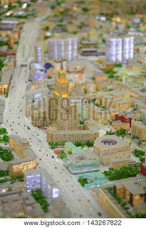 MOSCOW - DEC 20, 2014: Miniature of Stalinist skyscraper Ministry of Foreign Affairs in Moscow with illumination in VDNKH exhibition
