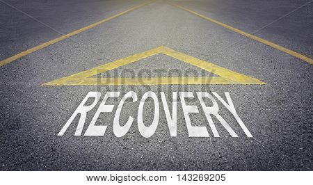 Recovery arrow direction sign on rough road.