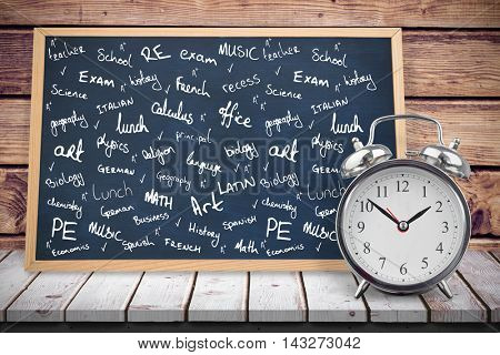 School buzzwords against composite image of black board