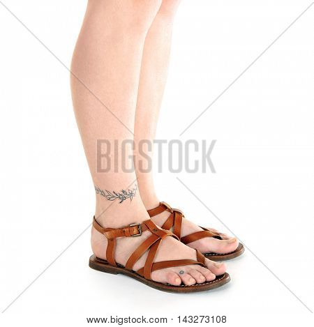 Female feet with tattoo, isolated on white